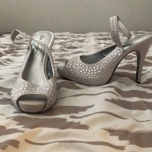 Silver strapped heels.